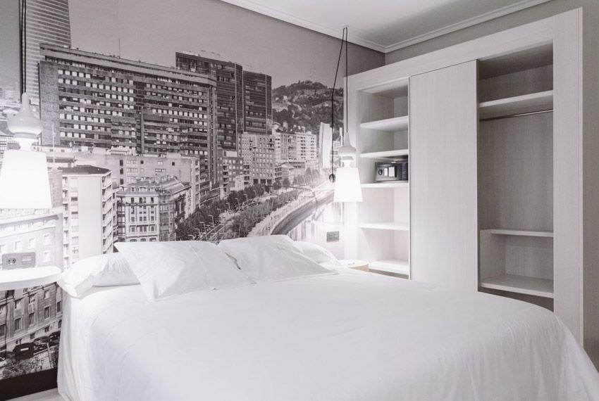 cabeceira com fotografia urbana para renovar a decoração